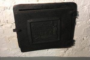 Ash pit door after treatment with Rustzilla rust treatment.