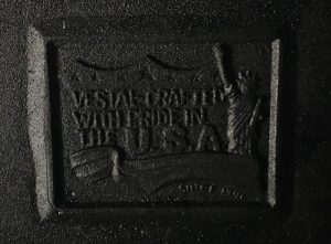 "Detail of Ash pit door: the design features stars, a banner and the Statue of Liberty. It reads: ""VESTAL – CRAFTED WITH PRIDE IN THE U.S.A."""