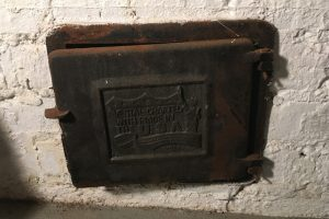 Ash pit door before treatment with Rustzilla rust treatment.